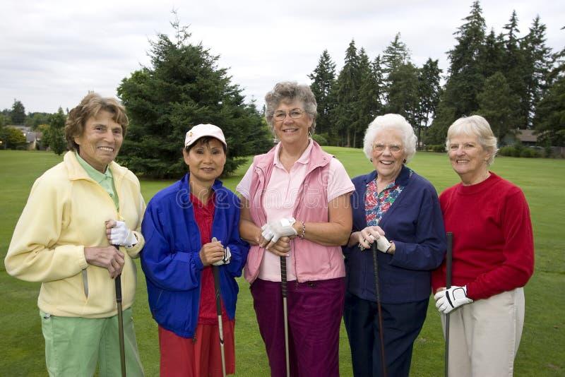 golfarekvinnor arkivfoto