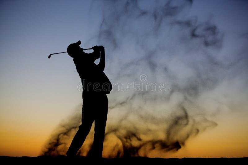 golfaresilhouette arkivfoto