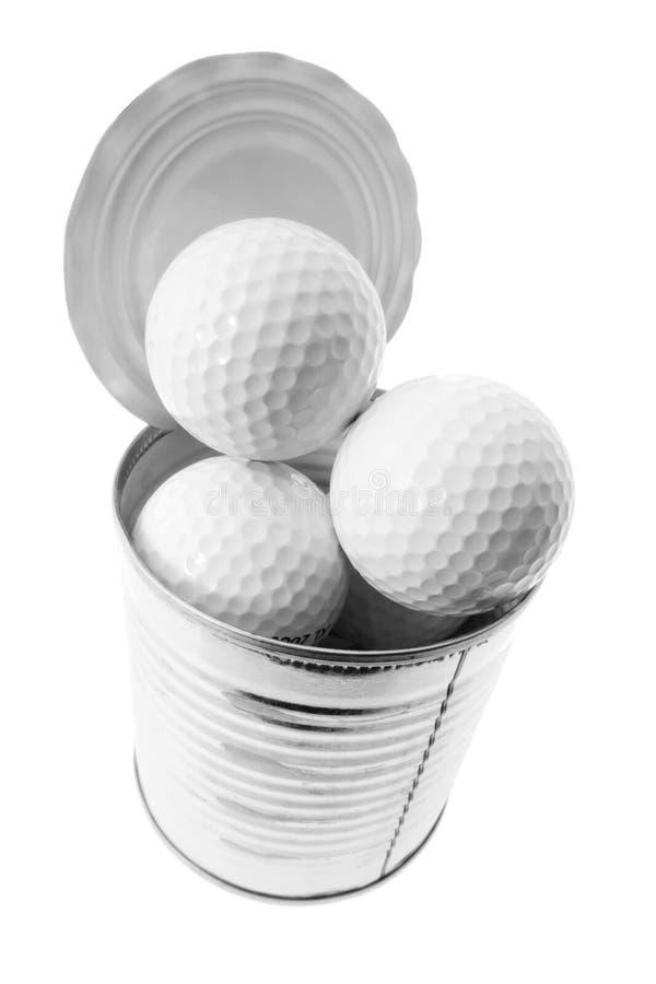 Golfbälle in der Blechdose lizenzfreies stockfoto