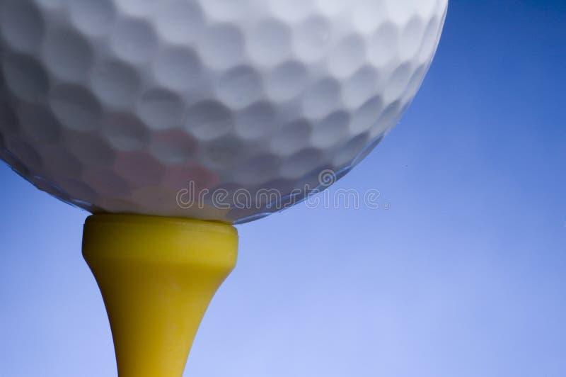 Golfbal en T-stuk royalty-vrije stock afbeeldingen