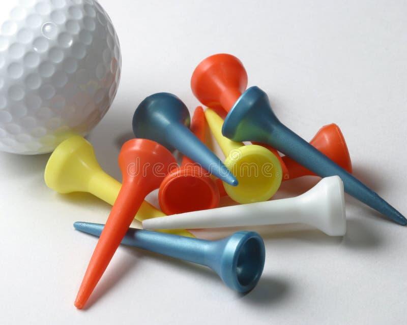 Golfball en T-stukken royalty-vrije stock afbeeldingen