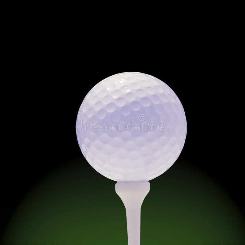 Golfball On Green And Black Royalty Free Stock Photo