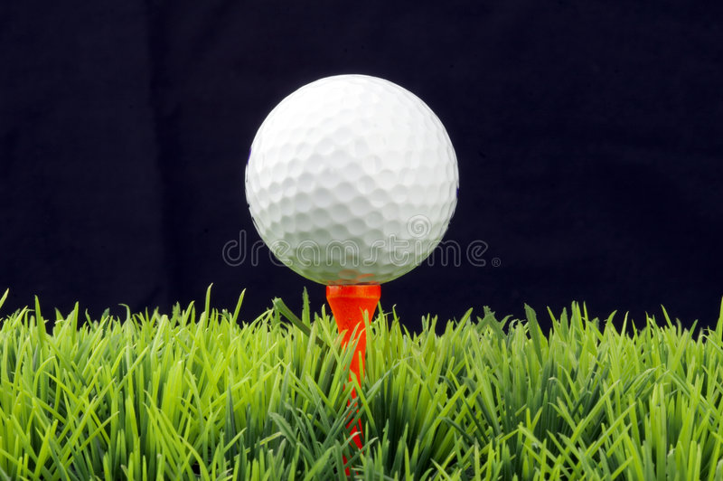 Golfball on tee royalty free stock photos
