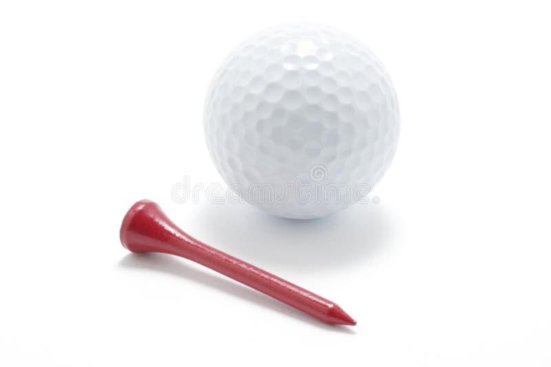 Golfball und Golf-T-Stück stockbilder