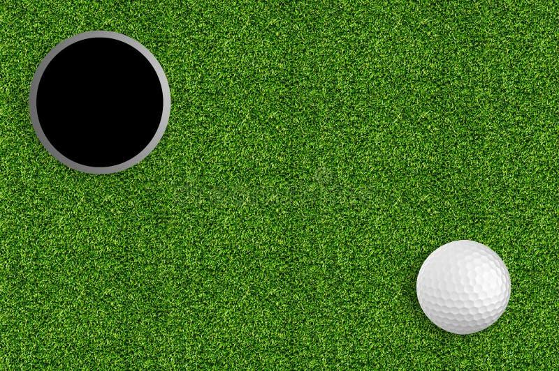 Golfboll och hål på det gröna gräset royaltyfri bild
