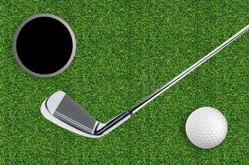 Golfboll och hål på det gröna gräset av golfen royaltyfria foton