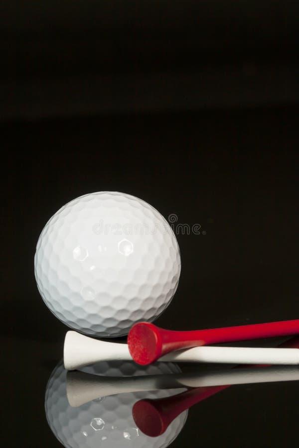 Golfboll och utslagsplatser 2 arkivfoto