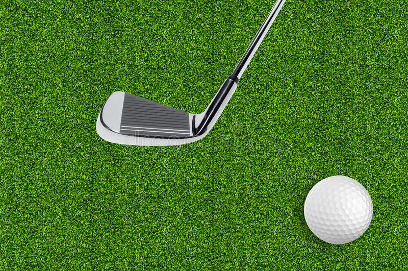 Golfboll på det gröna gräset av golfen royaltyfri bild