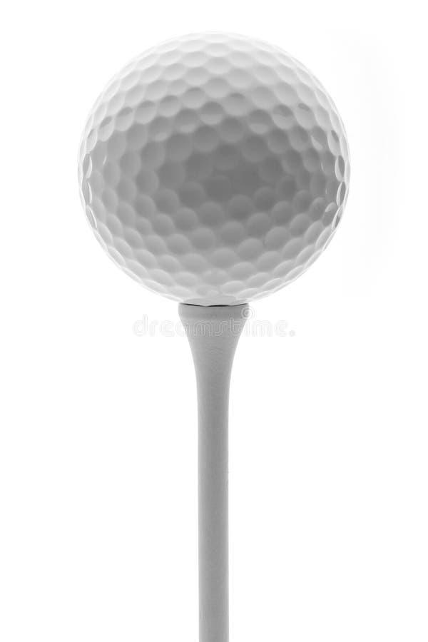 Golfboll på en utslagsplats royaltyfria bilder