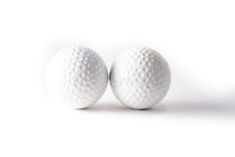 Golfboll på vit bakgrund arkivfoto
