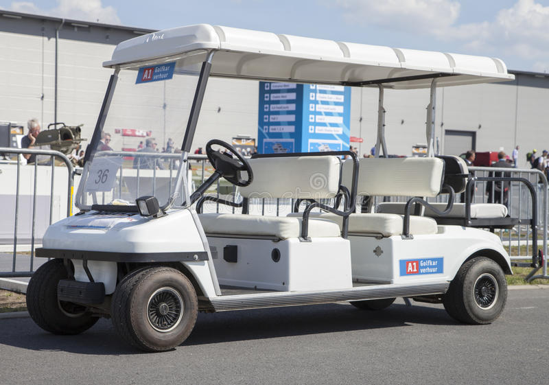 Golfcar stands on airport in berlin. BERLIN / GERMANY - JUNE 3,2016: a golfcar stands on airport in berlin royalty free stock photography