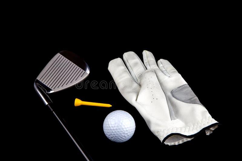 Golfclub met Handschoenbal en T-stuk op Zwarte Achtergrond royalty-vrije stock afbeelding