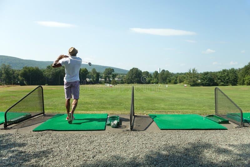 Golfe no driving range fotos de stock royalty free