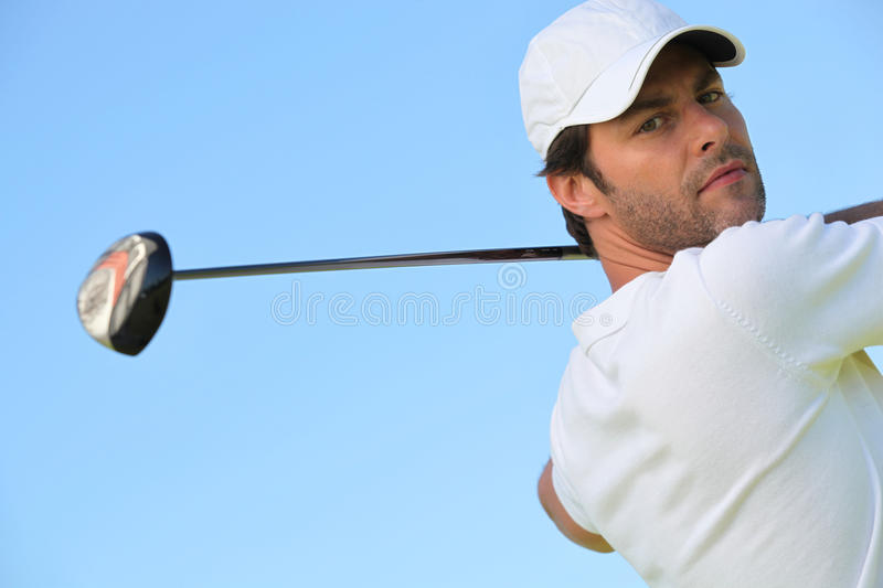 Golfer. Male golfer using his driver royalty free stock photo