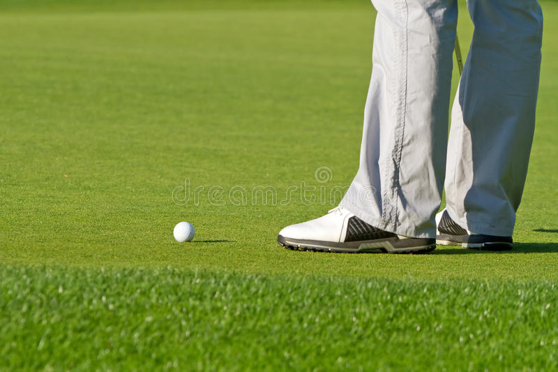 Golfer at the ball royalty free stock photography