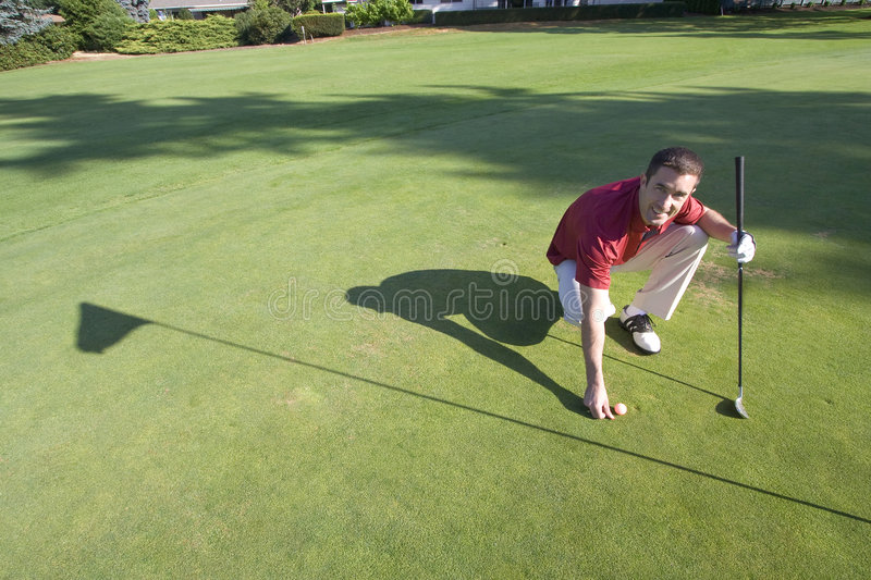 Download Golfer Bends To Mark Ball - Horizontal Stock Photo - Image: 6069408
