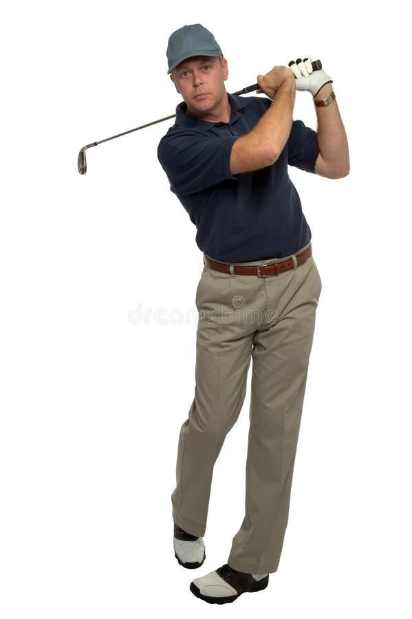 Golfer blue shirt iron shot royalty free stock photos