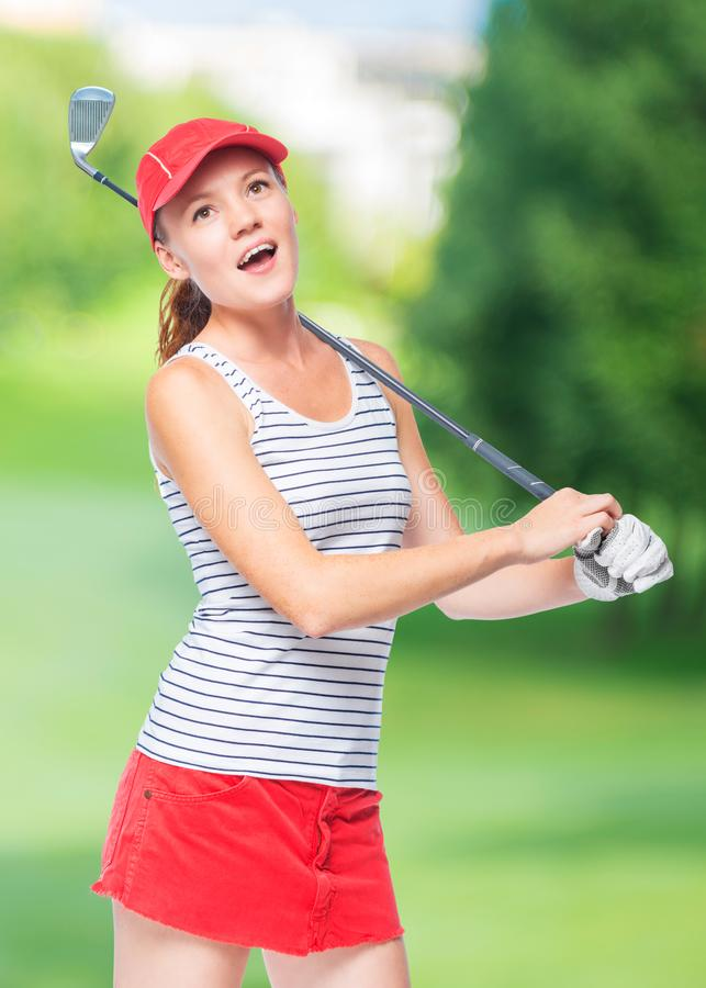 Golfer in cap with golf club stock photography