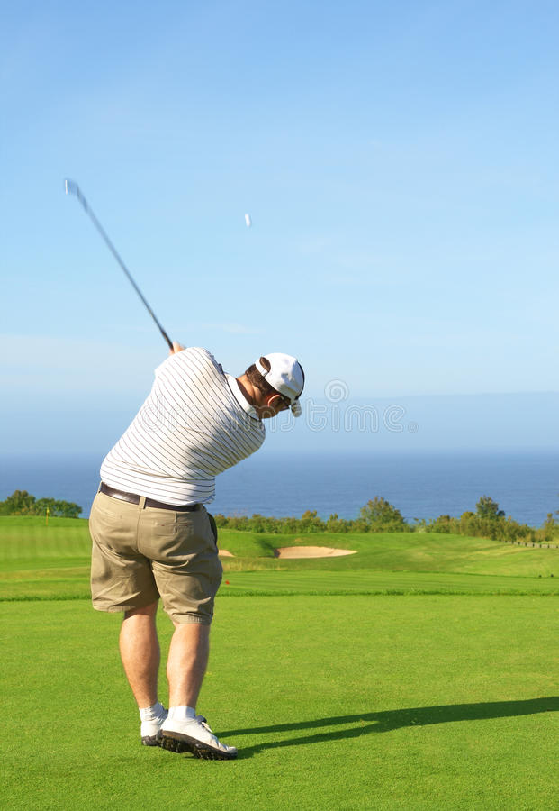 Golfer on the fairway royalty free stock images