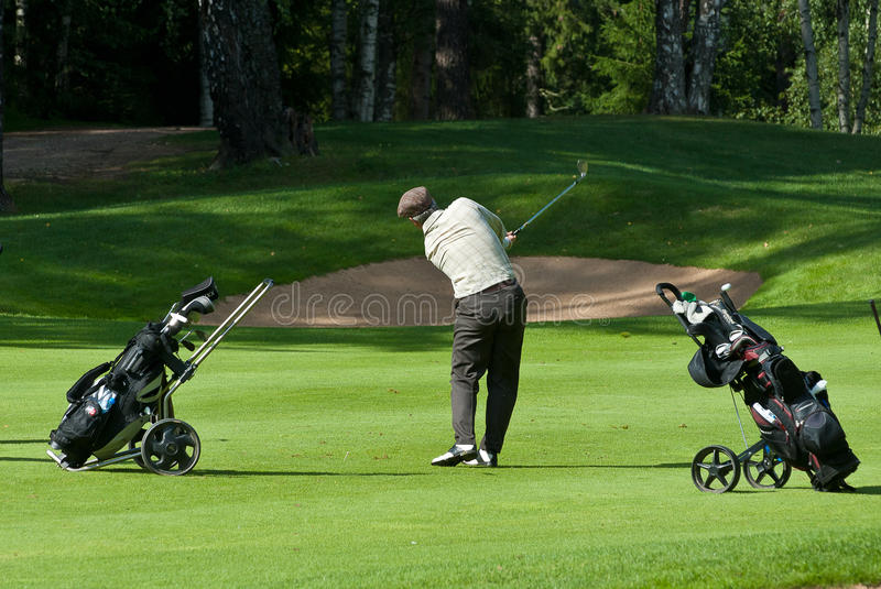 Download Golfer Finishes His Swing Editorial Image - Image: 18696240
