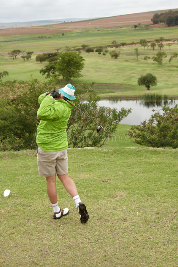 Download Golfer on follow-through stock photo. Image of outdoors - 13403944