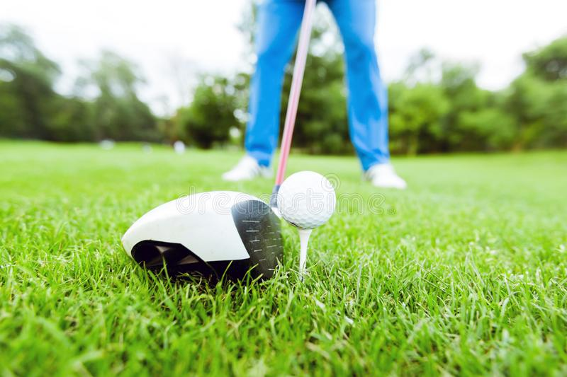 Golfer getting ready to take a shot stock photos