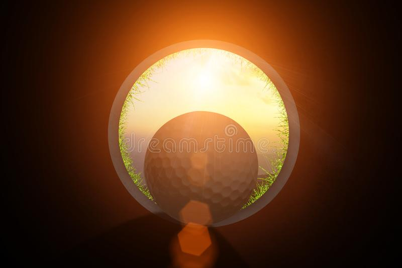 Golfer at golf ball view from inside the hole of cup in the green golf club play and lens flare on sun set evening time gold sky royalty free stock image