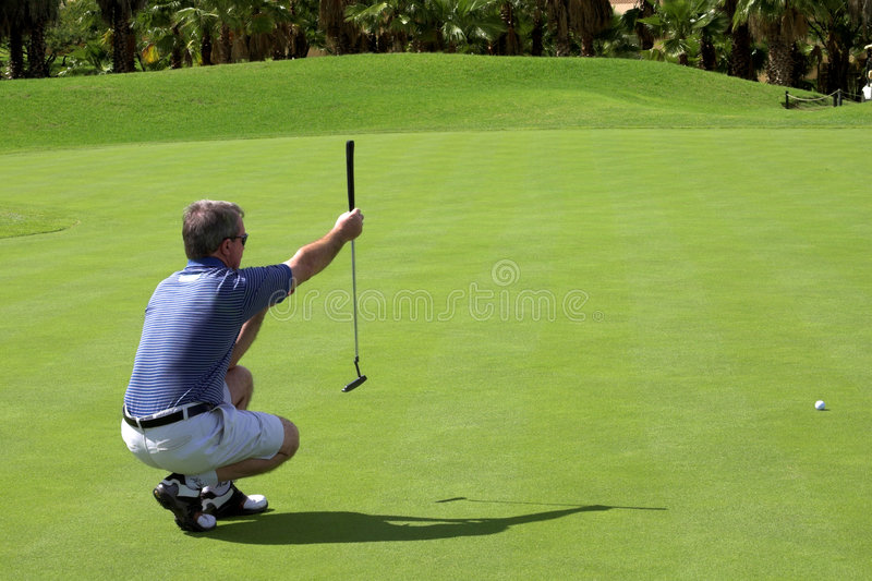 Golfer on the green stock photo