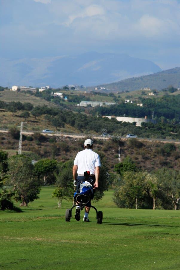Golfer with his buggy, Caleta de Velez. stock photos