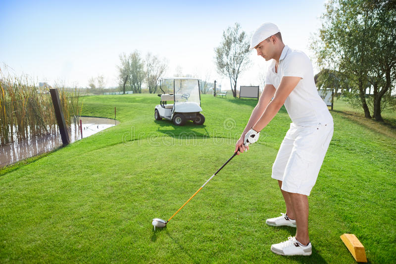 Golfer hitting golf ball royalty free stock photography