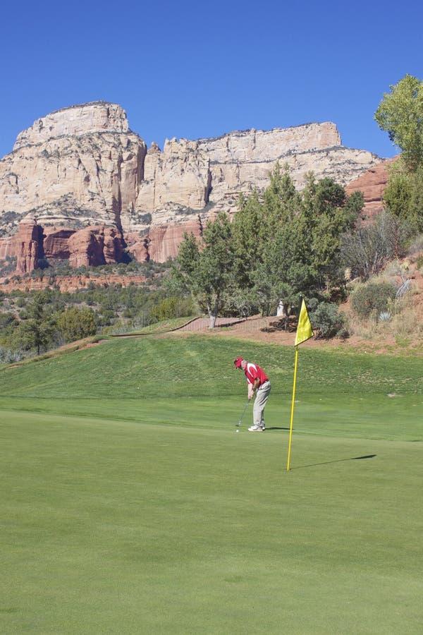 Golfer Hitting a Putt stock photo