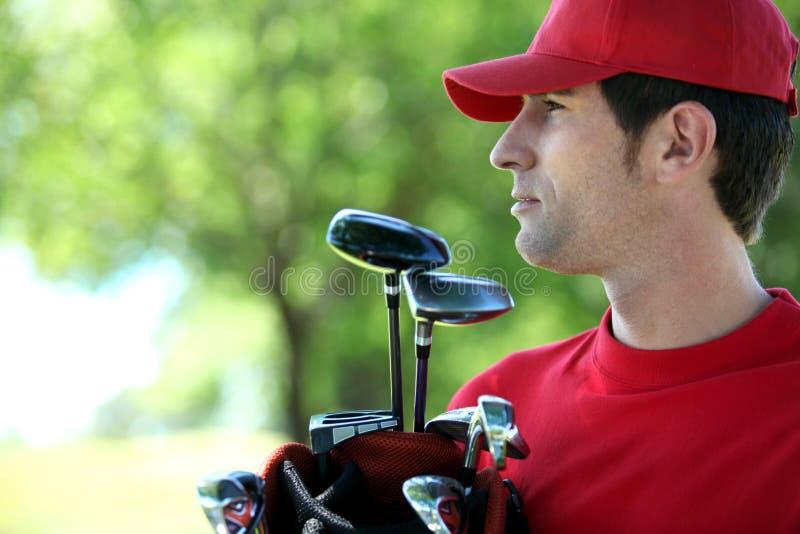 Golfer holding golf bag royalty free stock photos