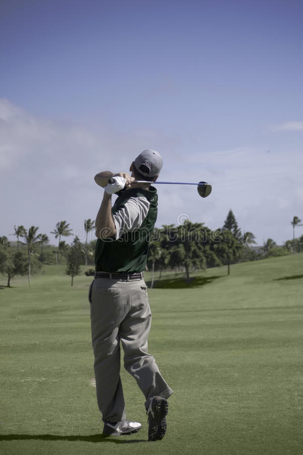 Free Golfer Holds His Backwing After Drive To Fairway Stock Photography - 22948912