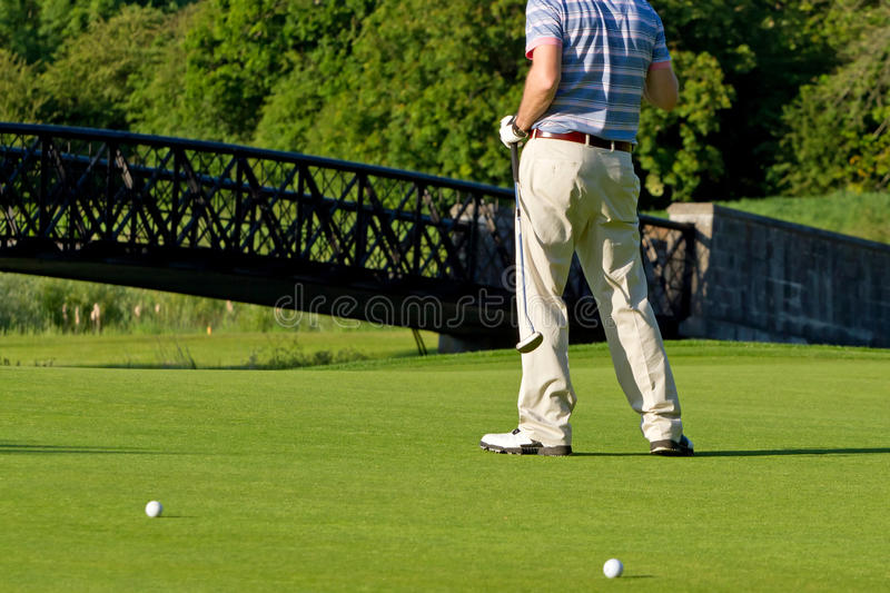 Golfer at the hole royalty free stock photo