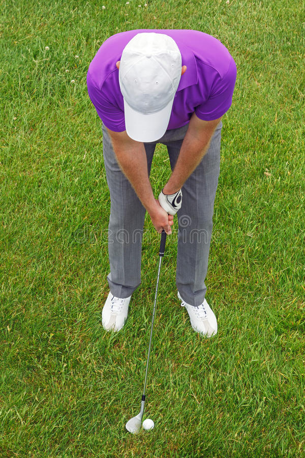 Golfer overhead shot from the rough. Overhead shot of a golfer playing an iron from the rough royalty free stock photo