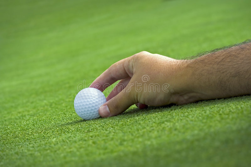 Download Golfer Placing The Ball Royalty Free Stock Photography - Image: 3609947
