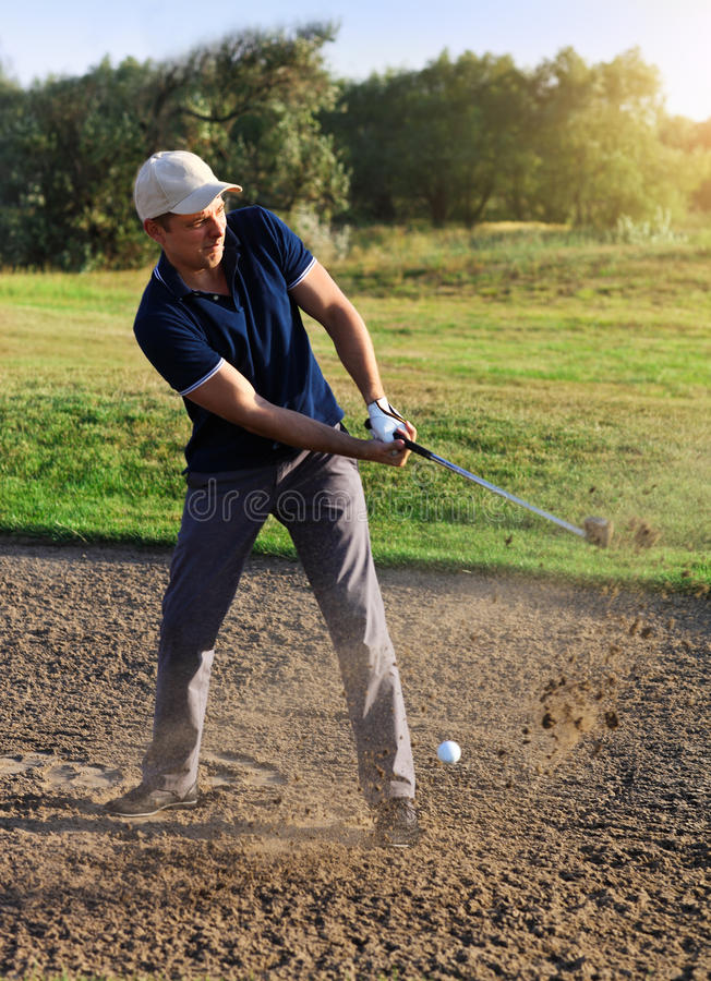 Golfer plays a sand trap shot stock images