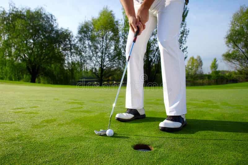Golfer putting royalty free stock image