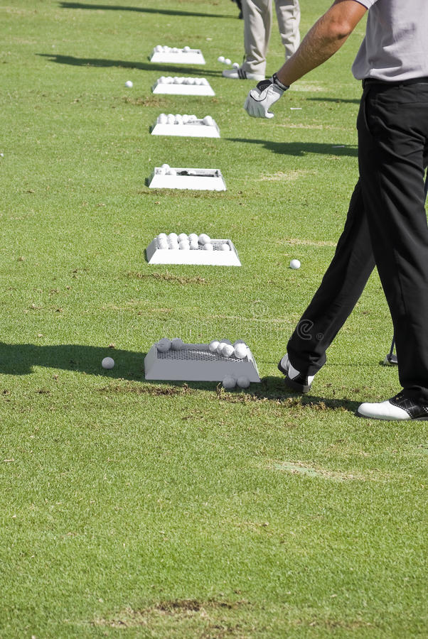 Download Golfer With Row Of Practice Balls Stock Photo - Image of balls, player: 12254746