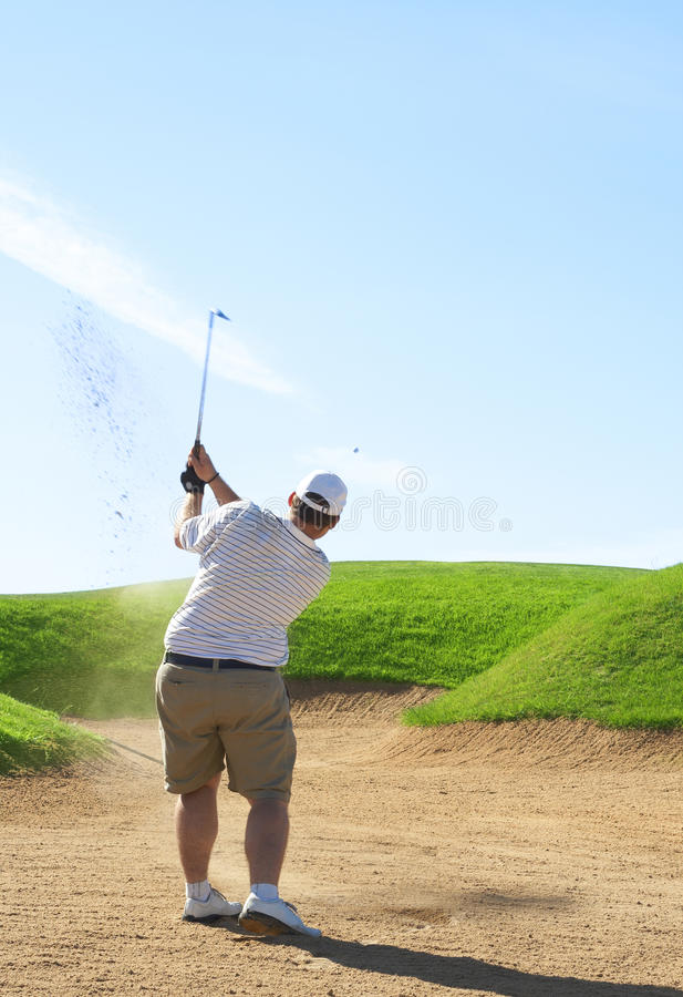Golfer in the sand bunker royalty free stock image
