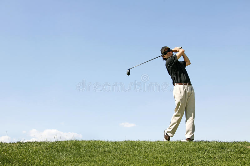 Download Golfer Shooting A Golf Ball Stock Photo - Image of action, golfing: 19988498