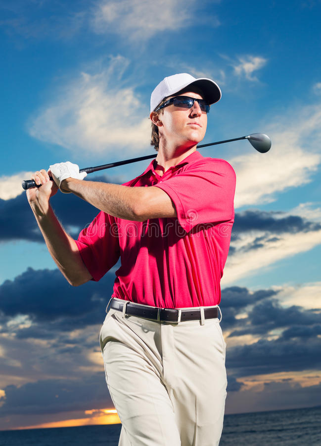 Golfer at sunset stock photos