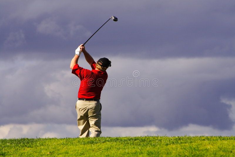 Golfer swing stock photography