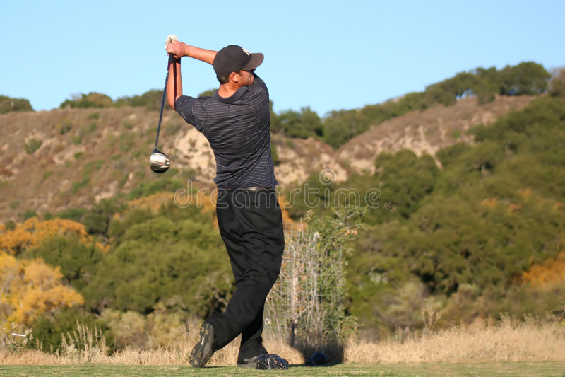 Golfer swing finish stock photo