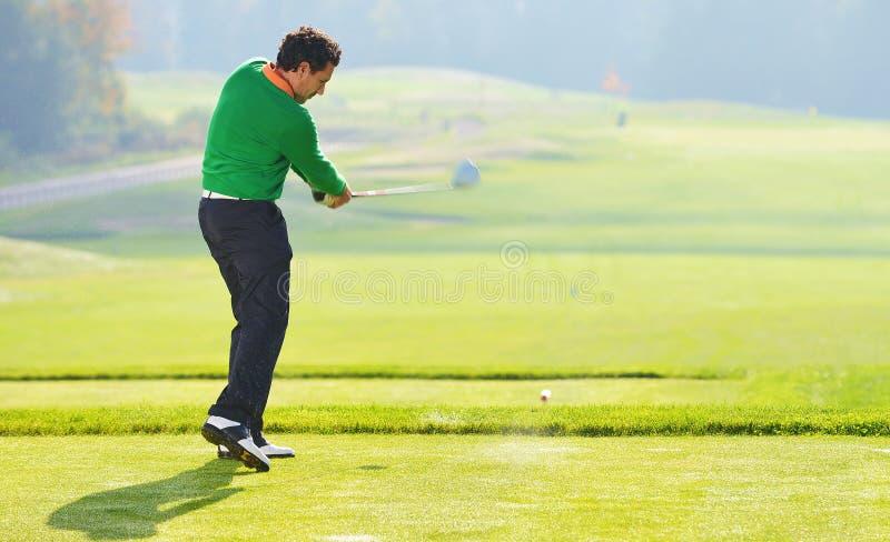Golfer swing royalty free stock photography