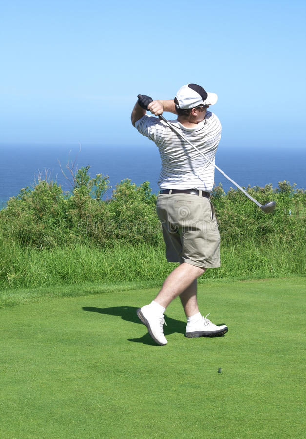 Golfer on the tee box royalty free stock image