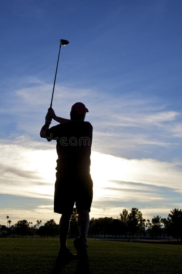 Download Golfer Teeing Off At Sunset Stock Photo - Image: 18025534