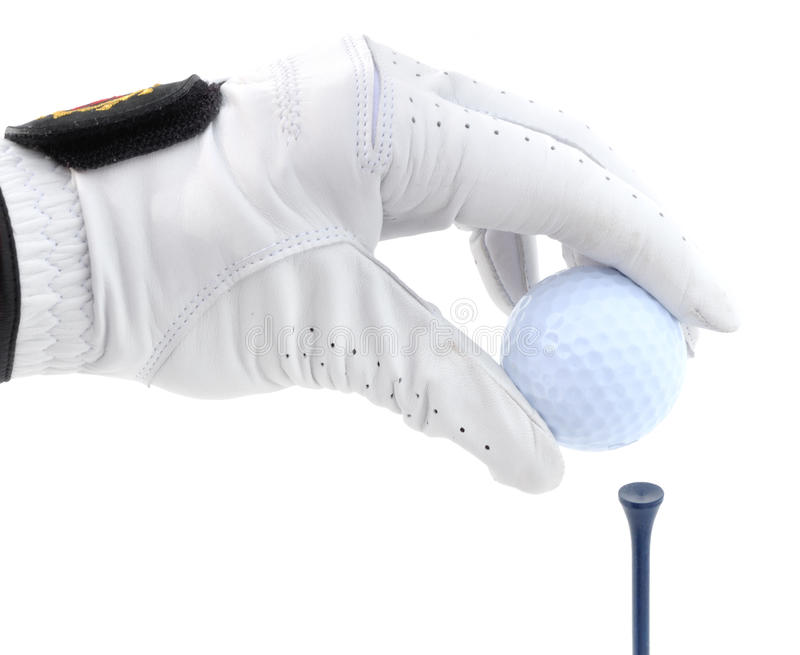 Golfer Teeing Up a Golf Ball stock image