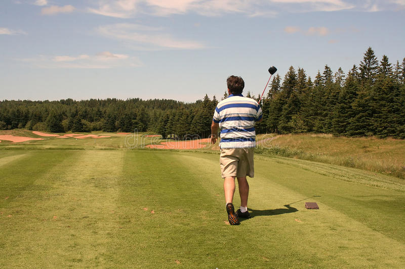 Golfer Tees Off royalty free stock image
