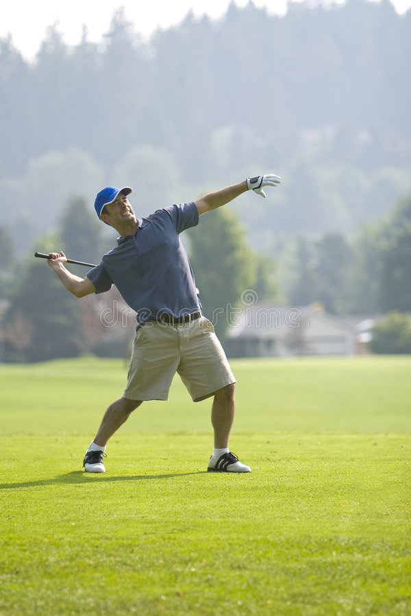 Golfer Throwing Club - vertical royalty free stock photography